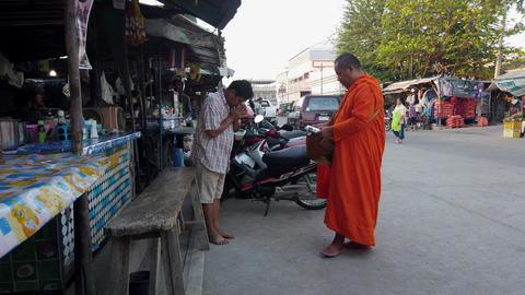 Sukhothai, Thailand - 2019-03-06 - Man Makes Donation To Monk Who Then Blesses Footage