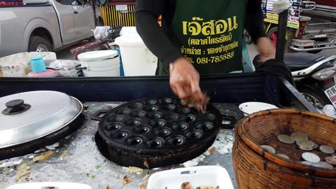 Sukhothai, Thailand - 2019-03-06 - Man Cleans Iron Depression Pan In Preparation Footage