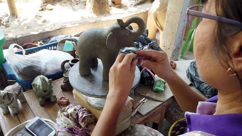 Sukhothai, Thailand - 2019-03-06 - Sculptor Puts Eyes On Clay Elephant Footage