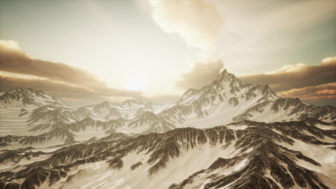 Panorama of High Snow Mountains at Sunset Live Action