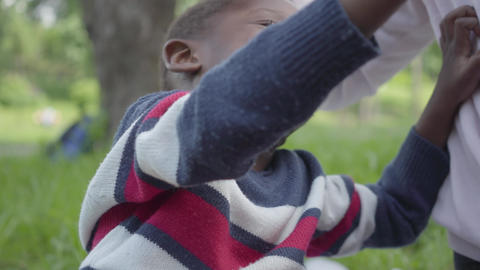 Portrait positive African American woman playing with her little son using Footage