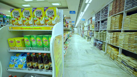 Interior shot of city supermarket, Various brand in packaging for sale on supermarket stand Live Action