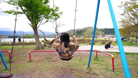 Woman enjoying a swing Footage