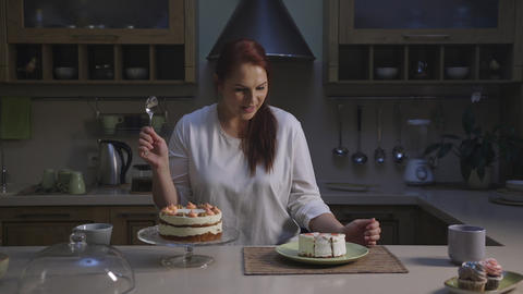 Woman cheating diet with appetizing cupcake pick a piece by spoon with pleasure Live Action