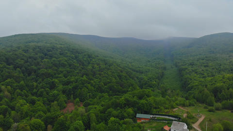 Aerial View. Flying over the beautiful mountain and beautiful forest. Landscape Footage