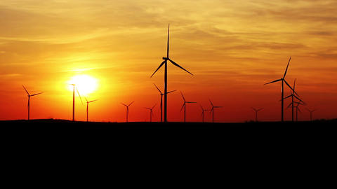 Wind Turbines Over Sunset Sky Generating Electricity. Sustainable Energy Archivo