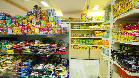 Varieties of cookies on the shelf in the supermarket. Fast Food Snacks For Sale On Supermarket Live Action