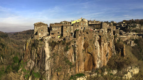 Aerial shot of comune and town of Calcata on high rock, Italy Live Action