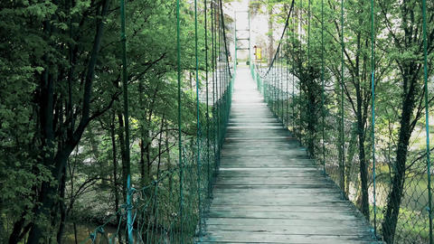 Fence on a pedestrian wooden bridge in the mountain in the summer Live Action