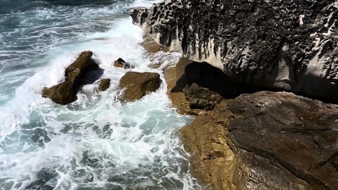 Waves crashing into rocks Stock Video Footage