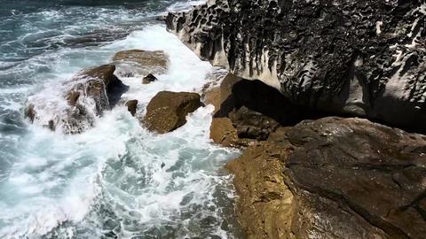 Waves crashing into rocks Footage