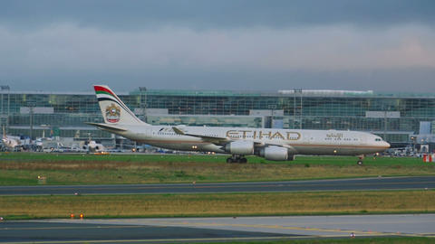 Etihad airbus 340 taxiing at early morning Footage