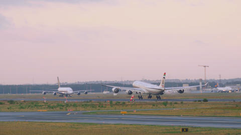 Etihad airbus 340 landing at early morning Live Action