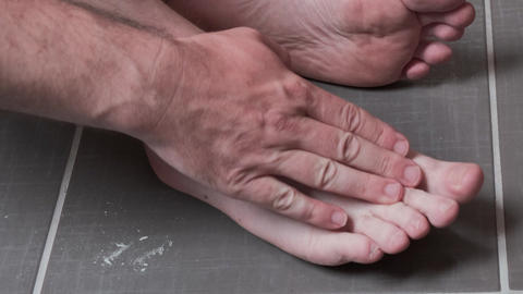 Man removing corn, callus from his feet using a razor file, masculine skin care Live Action