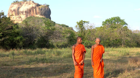 Haberna, Sri Lanka- 2019-03-22 - Two Young Monks Walk Towards Camera in Front of Footage