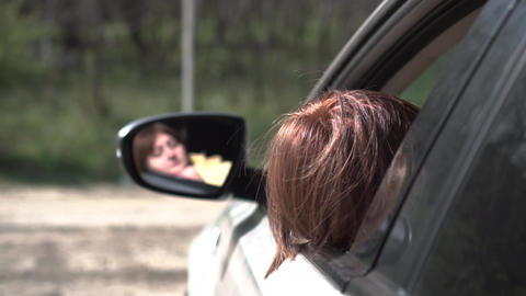 young girl fell asleep in the car behind the wheel Live Action
