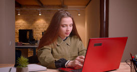 Portrait of pretty teenage girl working with laptop achieves the success gets Footage