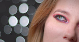 Half face portrait of pretty blonde model with bright make-up watching upwards Footage