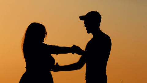 Romantic couple silhouette dancing at sunset Footage