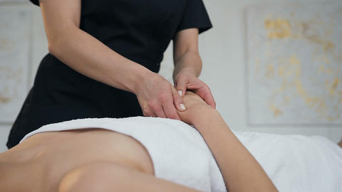 Professional female masseur making massage for female client in spa salon Footage