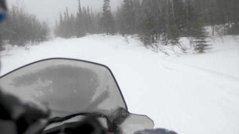 extreme snowmobile driver moves fast along narrow track Footage