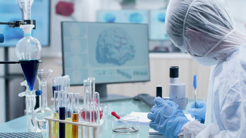 Scientists working in modern high end and secure laboratory Live Action