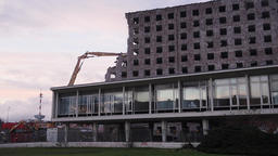 Partly Demolished Structure with Excavator Breaking Facade Exterior Footage