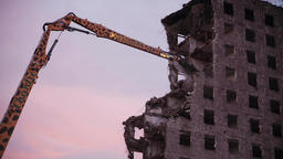 Demolition Arm Breaking Building Remnants and Twilight Sky Live Action