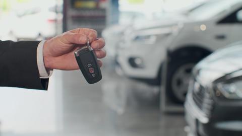 Salesman dealer hold a car keys Live Action