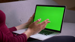 Profile shoot of businesswoman having a videocall on laptop with green chroma Footage