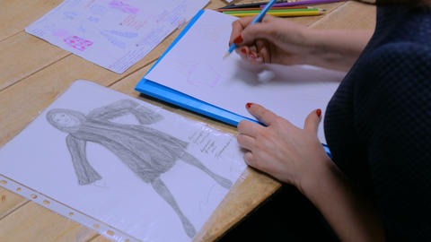 3 shots. Fashion designer drawing design sketch Footage