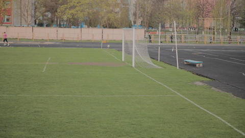 Football goal at the city stadium Live Action