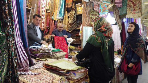 Shiraz, Iran - 2019-04-08 - Woman Buys Towel Live Action