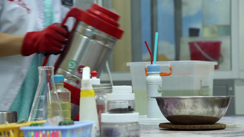 A lab technician doing experiments in the chemistry lab Footage