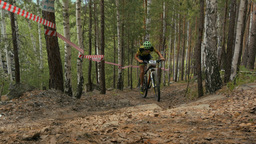 athlete a cyclist riding uphill on a forest trail Footage