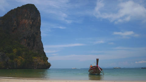 Tropical beach landscape of Railay Bay and boat Krabi, Thailand Live Action