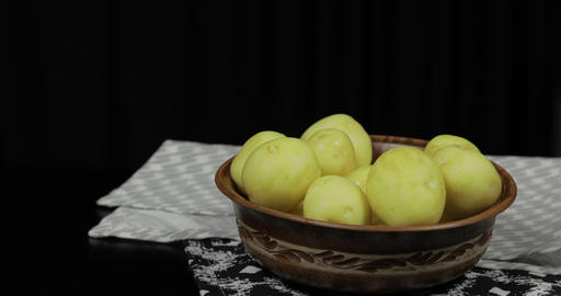 Woman hand takes potatoes one by one. Washed fresh raw potatoes Footage