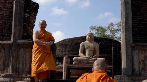 Polonnaruwa, Sri Lanka - 2019-03-23 - Monks On Tour 8 - Up Stairs Past Buddha Live Action