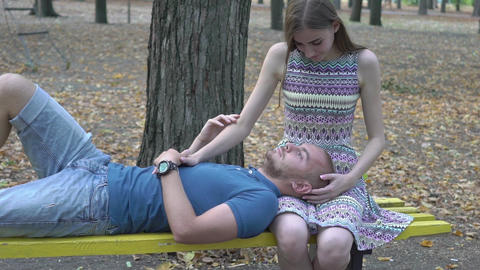 Real Time Young Attractive Couple Relaxing In Nature Footage