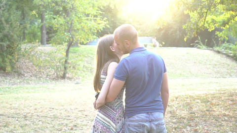 Slow Motion Young Couple Walking In A Park Together Over Sunset Live Action