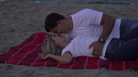 Slow Motion Girl And Her Boyfriend Lying Down At A Beach Live Action