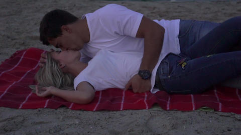 Slow Motion Girl And Her Boyfriend Lying Down At A Beach Stock Video Footage