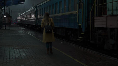 Real Time Young Blonde Woman Waits At Railway Station Watches Departing Train Footage
