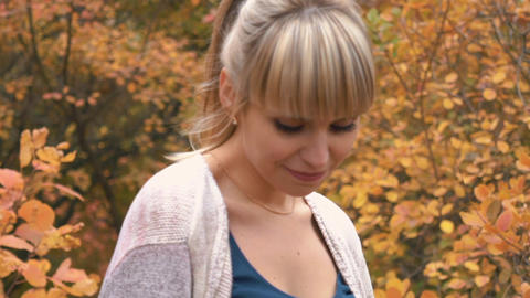 Slow Motion Beautiful Young Caucasian Girl With Makeup Poses On Camera In Autumn Footage