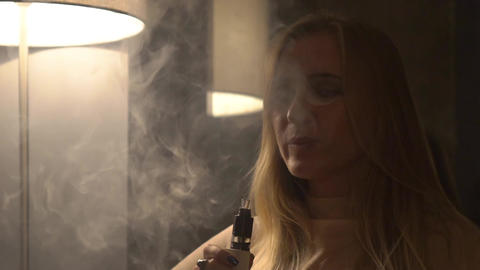 Slow Motion Pretty Woman Smokes Electronic Cigarette And And Makes Smoke Clouds Live Action