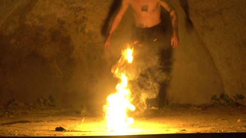 Slow Motion Fire Show Performance. A Man Picks Gasoline At A Torch Live Action