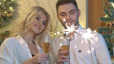 Beautiful Loving Couple Holding Glasses Of Champagne And Celebrating Happy New Footage