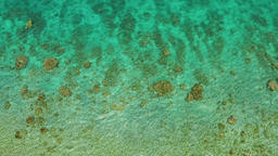 Aerial view of calm sea water. Top view of a clean ocean water near a coast Footage