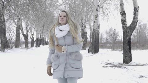Beauty Joyful Model Girl Having Fun In Winter Park. Beautiful Girl Walks In The Live Action