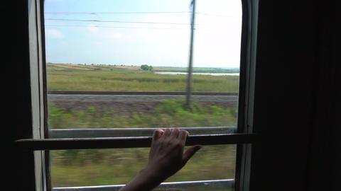 Woman hand holds handrail on the train window Footage